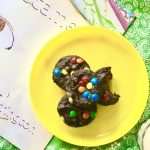 Three breakfast brownies on yellow plate, with the book She Became