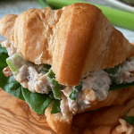 Smoked salmon salad sandwich on a wooden board